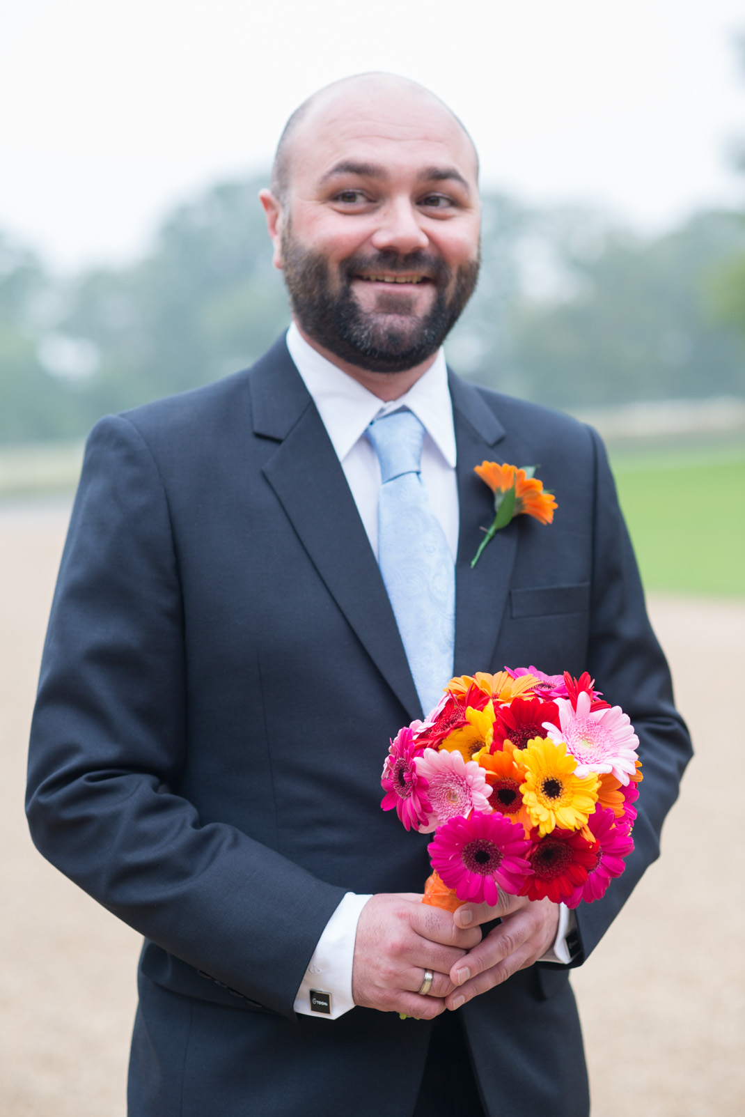 groom holding bouquet, funny, candid