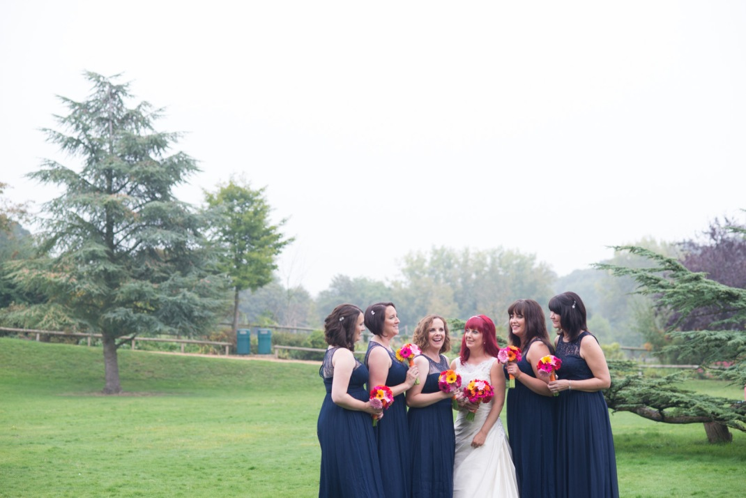 bride, bridesmaids, navy dresses, bold florals, fog, laugh, happy