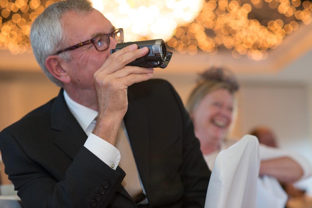 camcorder, wedding guests, bokeh