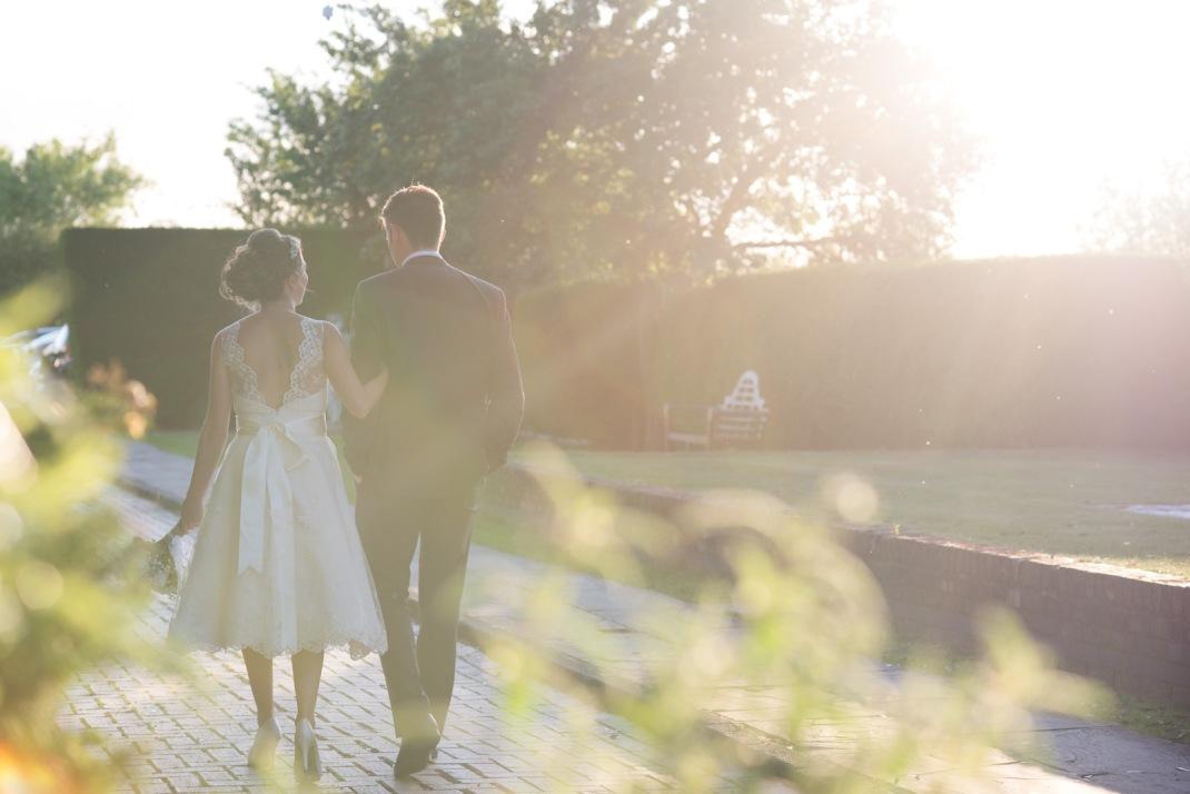 solar flare, sunshine, walking, happy, bride groom