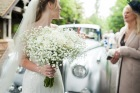 Bride holds bouquet before ceremony
