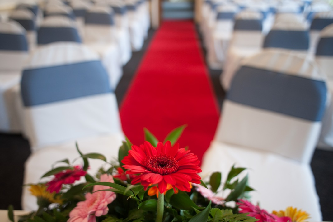 red flower, aisle, ceremony room, Marwell House